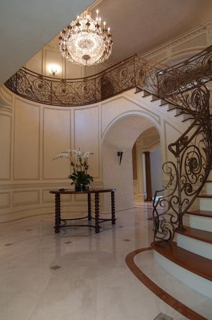 Traditional Entryway with Cathedral ceiling, Cabochons, curved staircase, Loft, Polished marble tile with cabochons, Paint