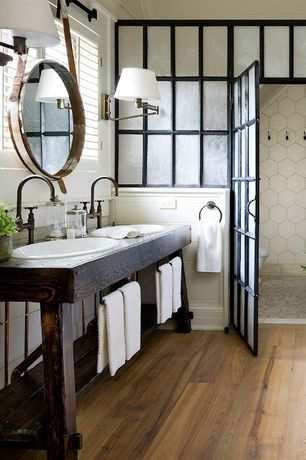 "Rustic Master Bathroom with Hardwood floors, Double sink, Jamie young leather strap 19"" high round wall mirror, Wall sconce"