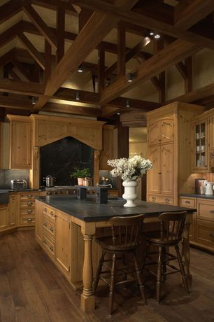 Traditional Kitchen with Knotty pine cabinet door, Spindle leg bar stool, Marble countertop, Exposed beam ceiling