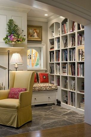 Living Room with Arched window, Crown molding, Guy chaddock collection poole skirted wing chair uc3153, Built-in bookshelf