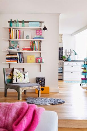 Eclectic Living Room with Built-in bookshelf, Hardwood floors