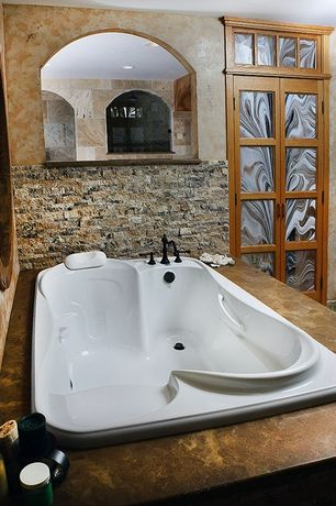 Rustic Hot Tub with exterior stone floors