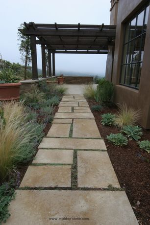 Mediterranean Landscape/Yard with Pathway, Casement, exterior tile floors, Trellis