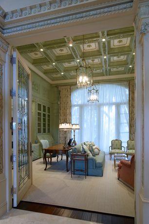 Mediterranean Home Office with High ceiling, Built-in bookshelf, Chandelier, can lights, Hardwood floors, French doors