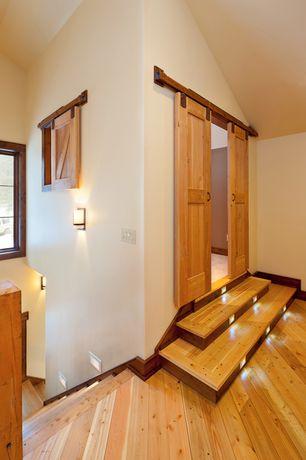 Country Hallway with Hardwood floors, High ceiling, Barn door