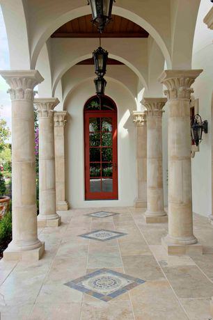 Mediterranean Porch with Arched window, French doors, Screened porch, Transom window, exterior stone floors