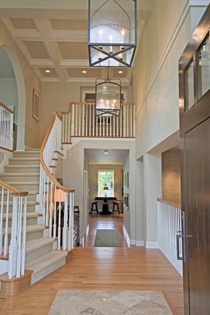 Traditional Entryway with Exposed beam, specialty door, High ceiling, Hardwood floors, Chandelier, Transom window