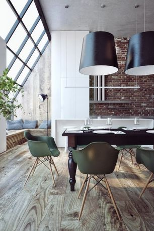 Contemporary Dining Room with Eames molded plastic dowel-leg armchair (daw), Skylight, Pendant light, Hardwood floors