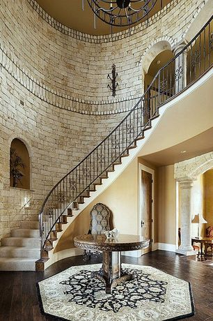 Mediterranean Staircase with Nourison persian arts traditional black rug, Hardwood floors, Cathedral ceiling, Stone columns