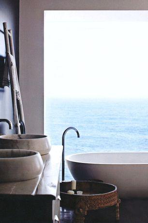 Contemporary Master Bathroom with Round limestone art natural stone sink vessel, Vessel sink, European Cabinets, Flush
