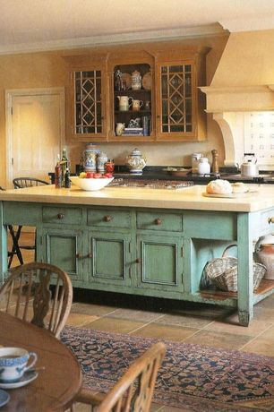 Country Kitchen with Breakfast bar, specialty door, Soapstone, Mexican Tiles Green Ville Mexican Tile, Ceramic Tile, One-wall