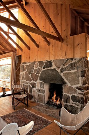 Rustic Living Room with High ceiling, Exposed beam, Hardwood floors, stone fireplace