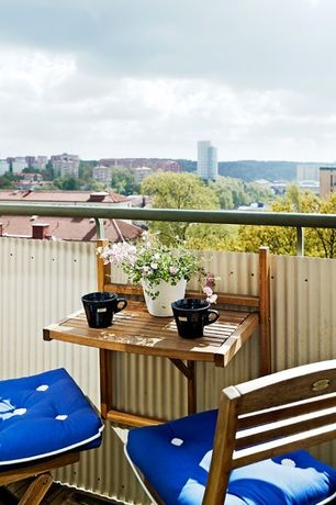 Eclectic Deck with Corrugated Fencing, Leisure Season Mounted Bar Table