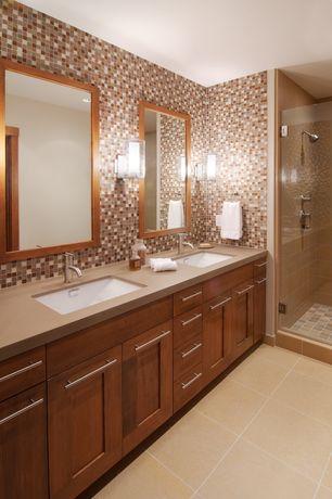 Contemporary Master Bathroom with frameless showerdoor, Ceramic Tile, full backsplash, Standard height, Flat panel cabinets