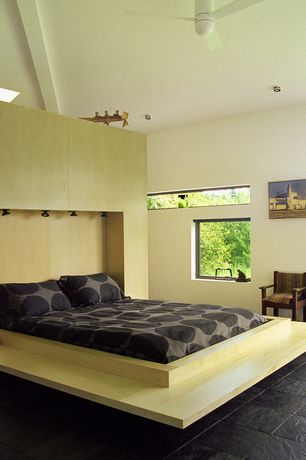 Modern Master Bedroom with Casement, soapstone tile floors, High ceiling, can lights, picture window, Ceiling fan
