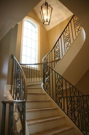 Mediterranean Staircase with High ceiling, Concrete floors, Arched window, flush light, curved staircase