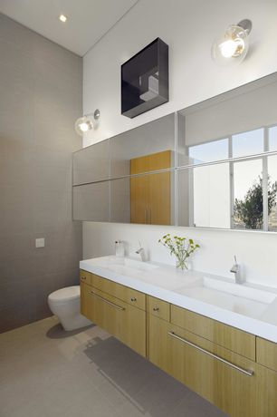 Contemporary Master Bathroom with Corian counters, Double sink, Standard height, travertine floors, European Cabinets, Flush