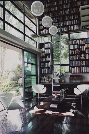 Contemporary Library with Transom window, Built-in bookshelf, Hardwood floors, Pendant light, Swan chair - white