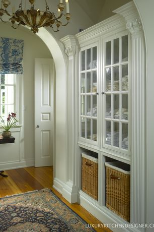 Traditional Closet with double-hung window, Hardwood floors, six panel door, High ceiling, Built-in bookshelf, Chandelier