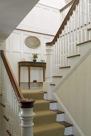 Traditional Staircase with Hardwood floors, Standard height, Wainscotting, Crown molding, curved staircase, Chair rail