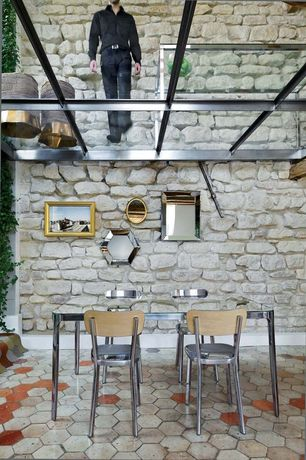 Modern Dining Room with Exposed beam, Howard Elliott Nexus Wall Mirror, Skylight, BCA Antiqued Limestone Hexagon Tiling