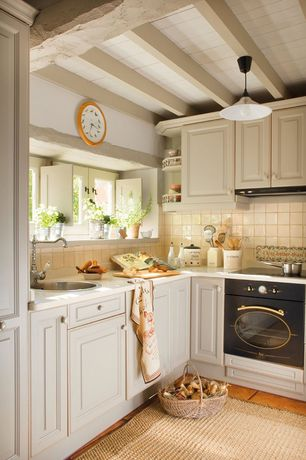 Country Kitchen with Large Ceramic Tile, stone tile floors, Paint, Raised panel, Exposed beam, Corian counters, drop-in sink