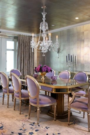 Contemporary Dining Room with Wall sconce, Concrete floors, Crown molding, Chandelier