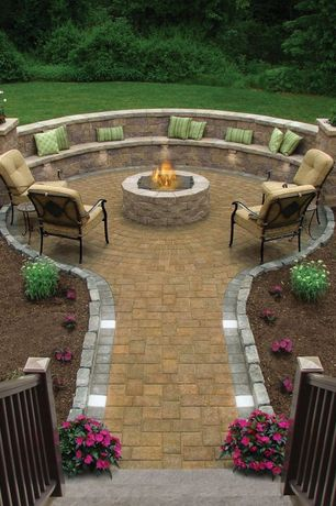 Traditional Patio with Pathway, Accent landscape lighting, Built-in bench seating, Curved outdoor bench, Fire pit