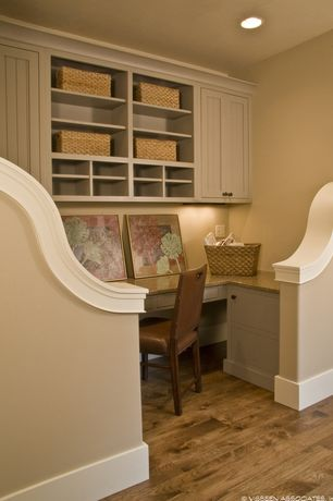 Traditional Home Office with Built-in bookshelf, Hardwood floors, Rattan utility baskets