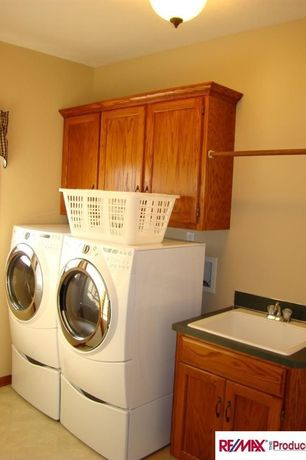 Craftsman Laundry Room with Built-in bookshelf, flush light, Concrete floors