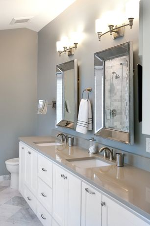 Traditional Master Bathroom with frameless showerdoor, Double sink, Limestone, Undermount sink, Limestone counters, Flush