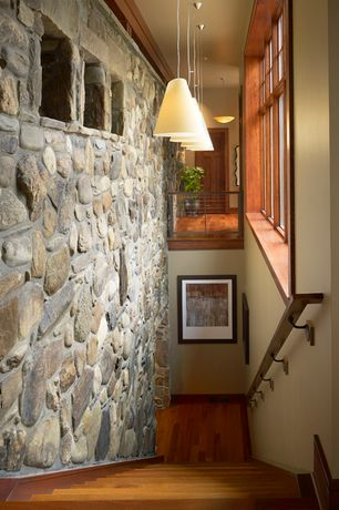 Rustic Staircase with Hardwood flooring, Pendant light, Wood framing, Natural stone wall, Cathedral ceiling, picture window