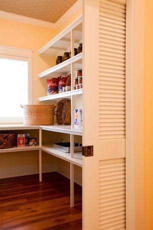 Traditional Pantry with Built-in bookshelf, Standard height, picture window, Crown molding, Hardwood floors, specialty door