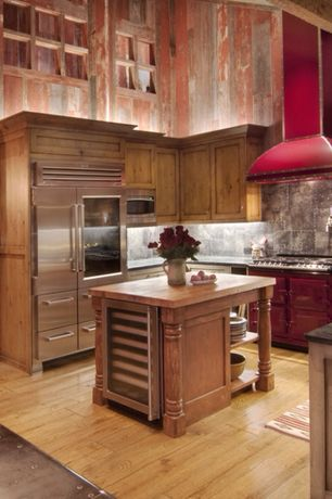 Rustic Kitchen with Stone Tile, Flush, Aga dual control 3-oven natural gas, Kitchen island, Slate counters, Exposed beam