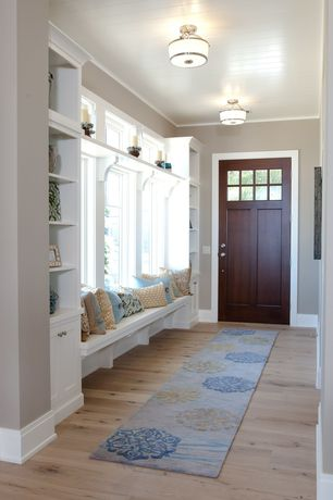 Traditional Entryway with Window seat, picture window, Crown molding, flush light, Hardwood floors, Standard height