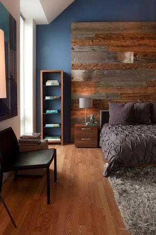 Modern Master Bedroom with Peel and Stick Reclaimed Wood, Hardwood floors, Built-in bookshelf, High ceiling