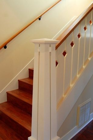 Cottage Staircase with Hardwood floors
