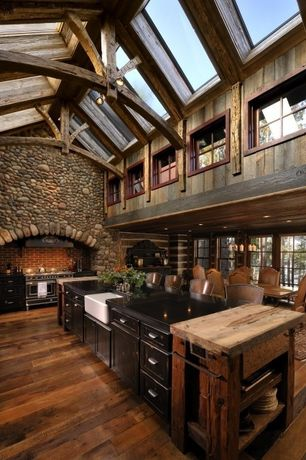 Rustic Kitchen with High ceiling, Elmwood Reclaimed Hand Hewn Wood Beams, Flat panel cabinets, Slate counters, Farmhouse sink