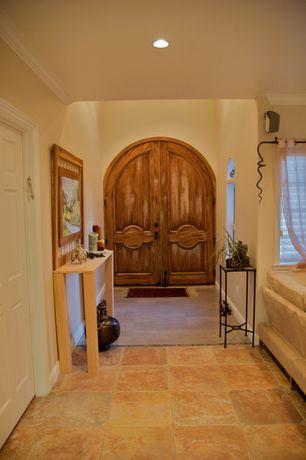 Rustic Entryway with Concrete tile , specialty door