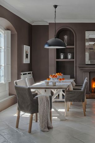 Contemporary Dining Room with Crown molding, Built-in bookshelf, Fireplace, Arched window, Pendant light, Standard height