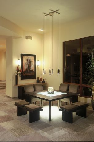 Contemporary Dining Room with complex granite tile floors, Wall sconce, Standard height, Pendant light, can lights
