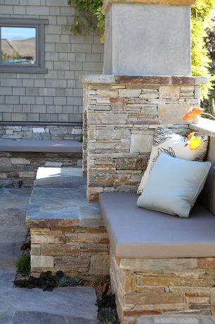 Cottage Patio with Decorative throw pillows, Built-in seating, Pathway, exterior stone floors