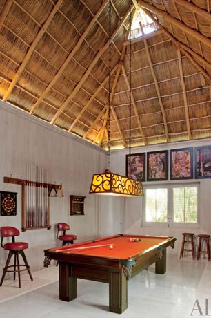 Tropical Game Room with simple marble tile floors, flat door, Cathedral ceiling, Pendant light, specialty window