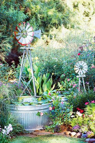 Eclectic Landscape/Yard with Witt Industries Galvanized Tub, Raised beds, Pond, Northern Tool + Equipment Ornamental Windmill