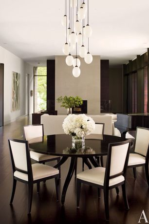 Modern Dining Room with Overstock 8-light edison bulb chandelier, Chandelier, Hardwood floors, Scan-design oval dining table