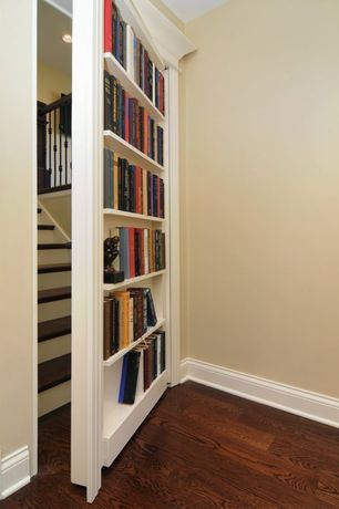 Traditional Hallway with Hardwood floors, Bi Folding Paint Murphy Door, Armstrong Wide Plank Oak Flooring, Built-in bookshelf