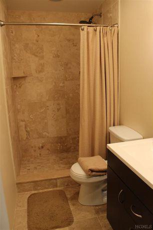 Contemporary 3/4 Bathroom with Limestone counters, Daltile Brancacci Fresco Cafe Ceramic Floor & Wall Tile, European Cabinets