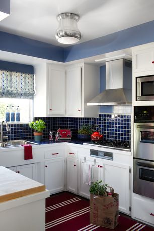 Contemporary Kitchen with Wall Hood, Multiple Sinks, electric cooktop, double-hung window, U-shaped, flush light, Paint