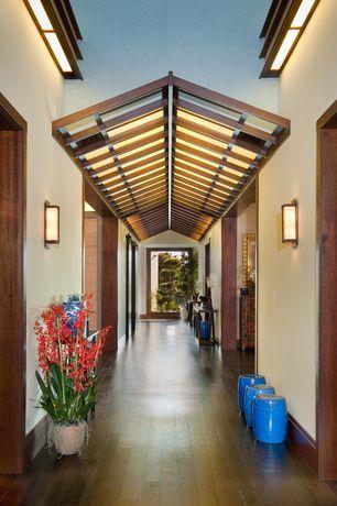 Asian Hallway with Sconce wall light, Hardwood floors, Pier1 - garden stool