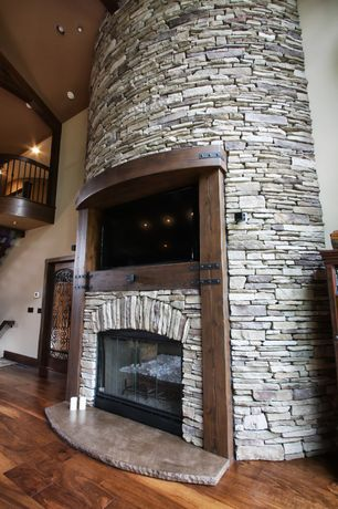 Country Great Room with Black Bear Manufactured Stone Carolina Ready Stack Granite, Hardwood floors, Recessed lighting